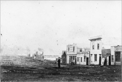 Man standing in street in Hokitika in 1867 (68)